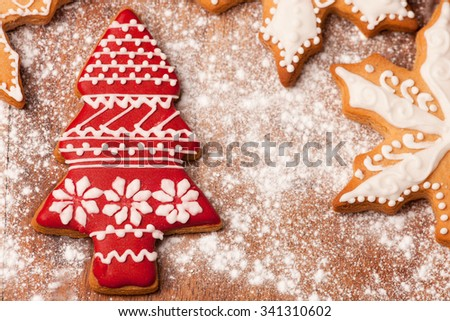 Lovely christmas tree gingerbread cookie decorated with red icing