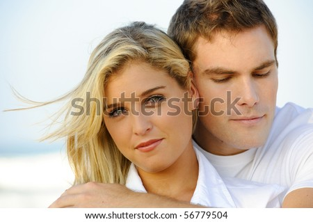 Lovely closeup portrait of an attractive young couple - stock photo