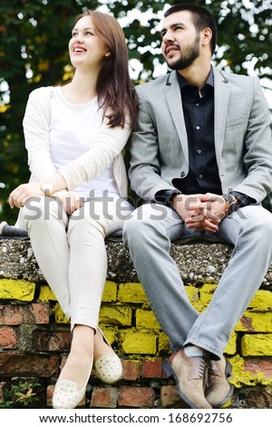 Lovely couple enjoying fall in love at park - stock photo