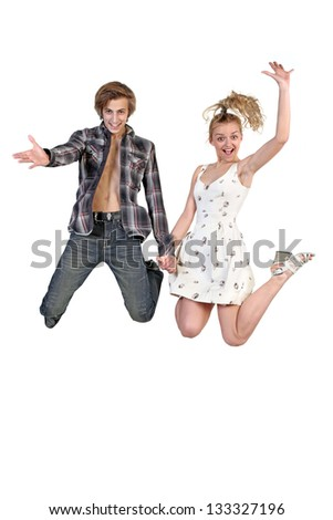 Lovely couple holding hands and jumping  over a white background - stock photo
