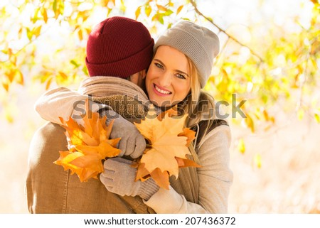 lovely couple hugging in autumn forest - stock photo