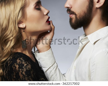 lovely couple in tenderness.Beautiful woman with the man.beauty girl and boy together.love touch on Saint Valentine's Day - stock photo