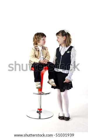 Lovely couple of little boy and girl - stock photo