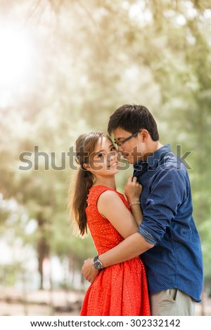 lovely couple people lifestyle romance in the garden. - stock photo