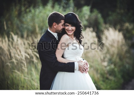 Lovely couple spends time in the field .Taken at sunset with natural light - stock photo