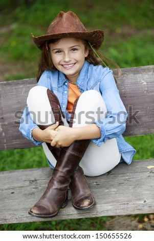 Lovely cowgirl  on a ranch - stock photo