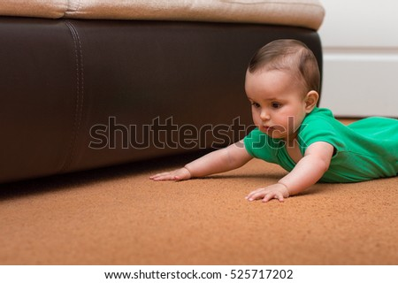 lovely crawling six-month baby