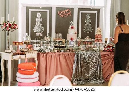 Lovely decorated wedding table with the sweet assortie