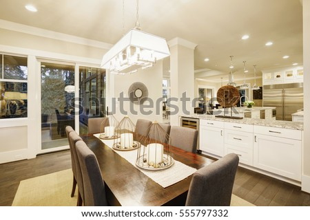 Lovely Dining Room With Rectangular Table Paired Grey High Back Chairs Over Sisal