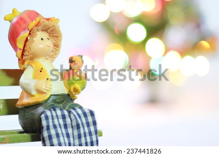 Lovely doll with Christmas Trimmings and Christmas Lights on white background - stock photo