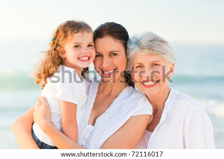 Lovely family at the beach - stock photo