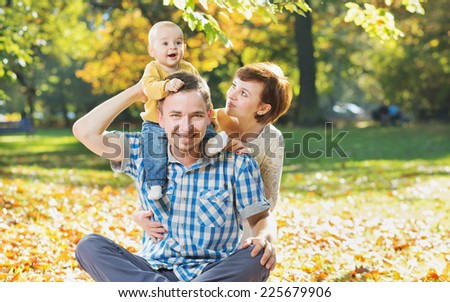 Lovely family enjoying weekend in the park