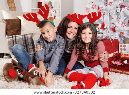 Lovely family portrait at Christmas - stock photo