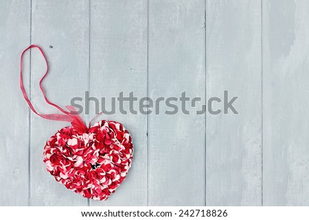 Lovely floral heart over a wooden background for St. Valentine's Day with room for copy space. - stock photo
