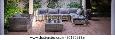 Lovely furniture in luxury villa backyard patio