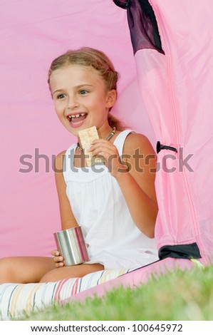 Lovely girl camping in tent - stock photo