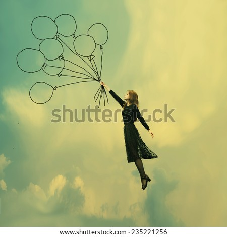 lovely girl in black dress dreams of Ballooning - stock photo