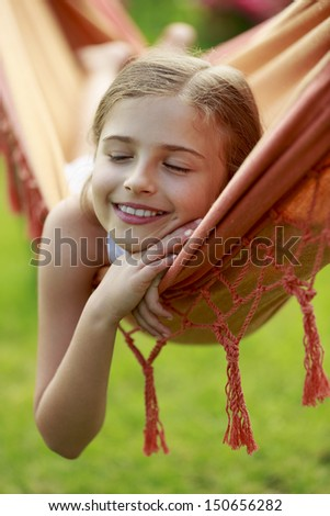 Lovely girl in hammock - stock photo
