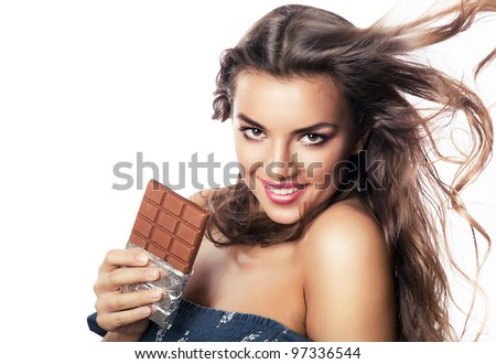 lovely girl with long hair and chocolate bar on white background - stock photo