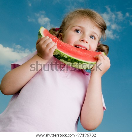 Lovely girl with watermelon