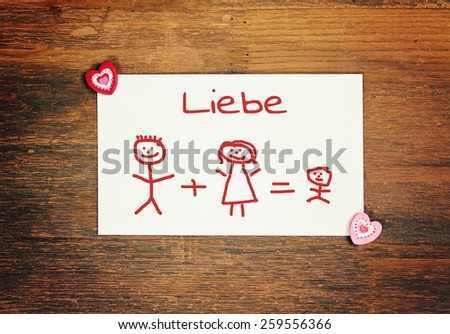 lovely greeting card - german for love -  matchstick man - stock photo