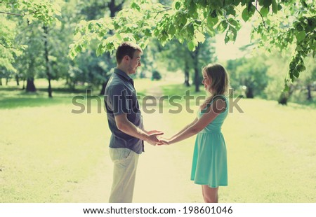 Lovely happy couple in love, date, relationships, wedding - concept, vintage soft colors - stock photo
