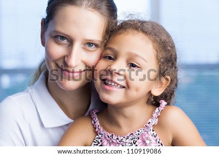 Lovely happy family of two looking at camera - stock photo