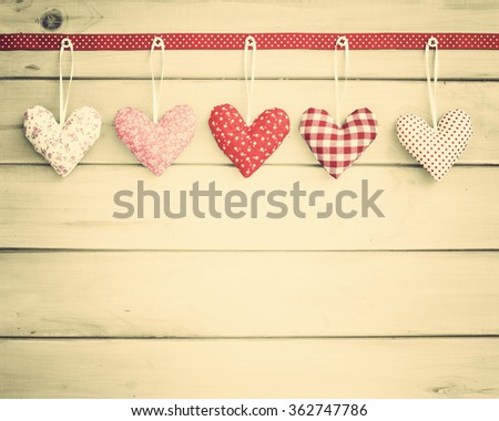 Lovely hearts over wood  - stock photo