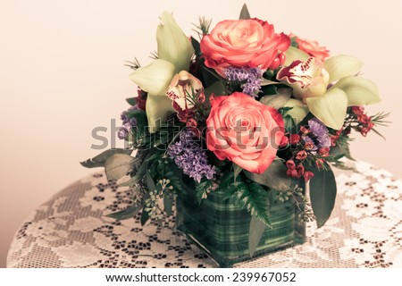 Lovely imaged of desaturated flower arrangement. - stock photo