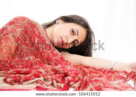 Lovely indian woman with red bridal saree - stock photo