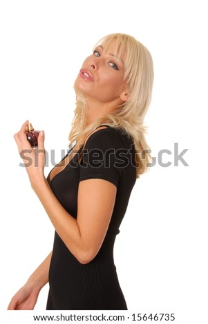 Lovely isolated blond girl spraying on perfume