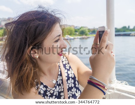 Lovely Italian girl inside the steamship in Istanbul city,Turkey taking photo of seascape
