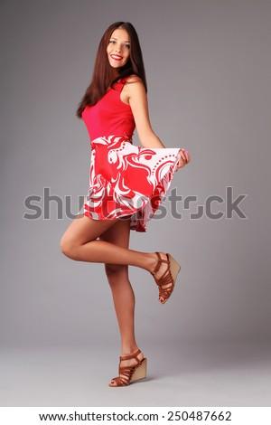 Lovely joyful woman is jumping - stock photo