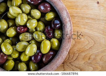 Lovely, juicy, fat olives from the Mediterranean, in rustic bowl. - stock photo