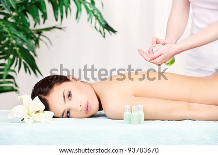 Lovely lady getting a back massage - stock photo