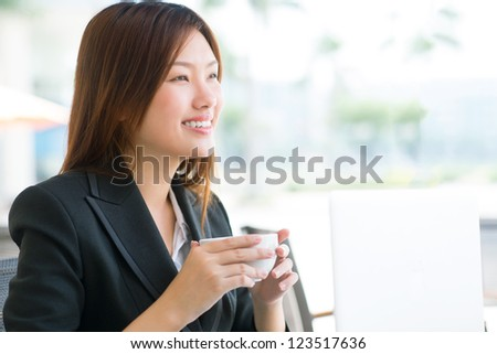 Lovely lady with confident smile enjoying her tea