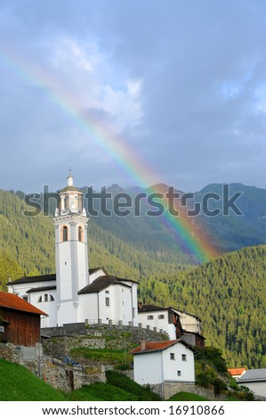 lovely landscape featuring a small church and a rainbow