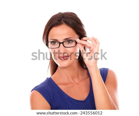 Lovely latin lady with glasses smiling and looking cheerful in white background - copyspace - stock photo