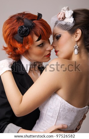 lovely lesbian gay couple just married and kissing - stock photo