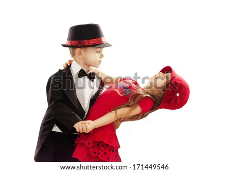 Lovely little boy and girl dancing. Isolated on white background - stock photo