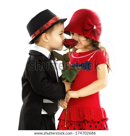 Lovely little boy giving a rose to fashionable girl and her excited. Love concept. Isolated on white background - stock photo
