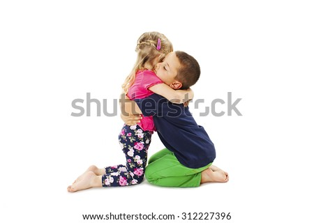 Lovely little brother embracing his baby sister. Isolated on white background   - stock photo