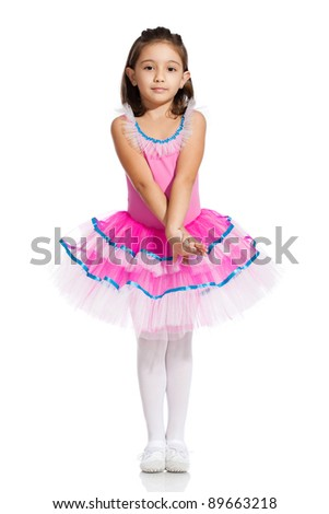 lovely little girl, dressed as a ballerina, isolated on white background