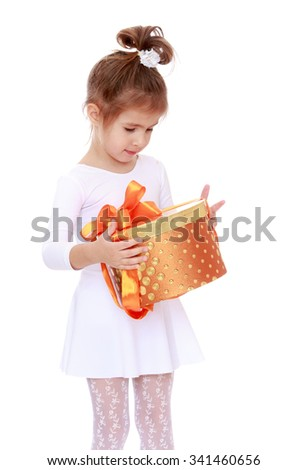 Lovely little girl in a short white dress, holding a round box which is a Christmas gift. Closeup-Isolated on white background - stock photo