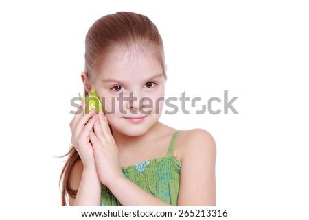 Lovely little girl with green Easter egg isolated over white background - stock photo