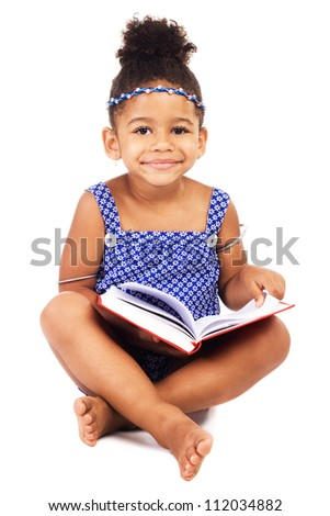 Lovely little girl with notebook sitting on white background - stock photo