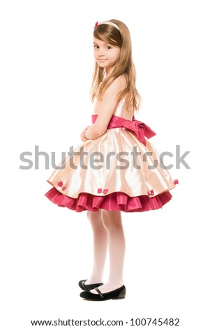 Lovely little lady in a dress. Isolated