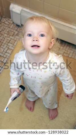 Lovely little toddler girl with tooth-brush - stock photo