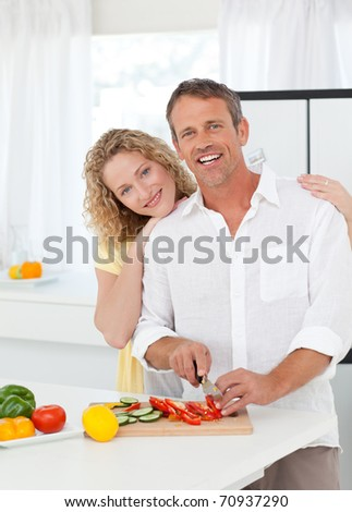 Lovely lovers looking at the camera at home - stock photo