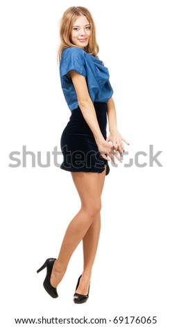 Lovely model in fashionable gown against white background - stock photo